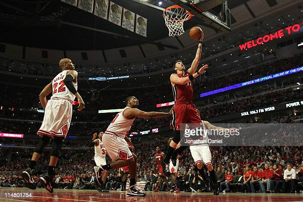 Mike Miller of the Miami Heat drives for a shot attempt against Kurt Thomas of the Chicago Bulls in Game Five of the Eastern Conference Finals during...