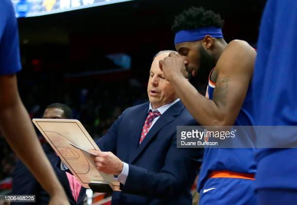 Mike Miller of the New York Knicks draws up a play with Mitchell Robinson of the New York Knicks during the second half of a game against the Detroit...
