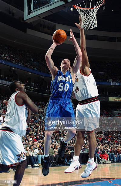 Mike Miller of the Orlando Magic shoots against Derrick Coleman of the Philadelphia 76ers during the game at First Union Center on February 14 2003...