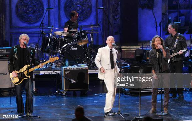 Mike Mills and Michael Stipe of REM perform with Eddie Vedder onstage at the 22nd annual Rock And Roll Hall Of Fame Induction Ceremony at the Waldorf...