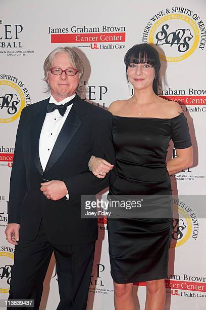 Mike Mills founding member of REM and Holly Selph attend the 2011 Julep Ball during the 137th Kentucky Derby at the Galt House Hotel Suites Grand...