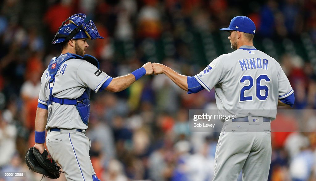 Mike Minor #26 of the Kansas City Royals celebrates with catcher Drew Butera #9 after the defeating the Houston Astros 7-3 at Minute Maid Park on April 8, 2017 in Houston, Texas.