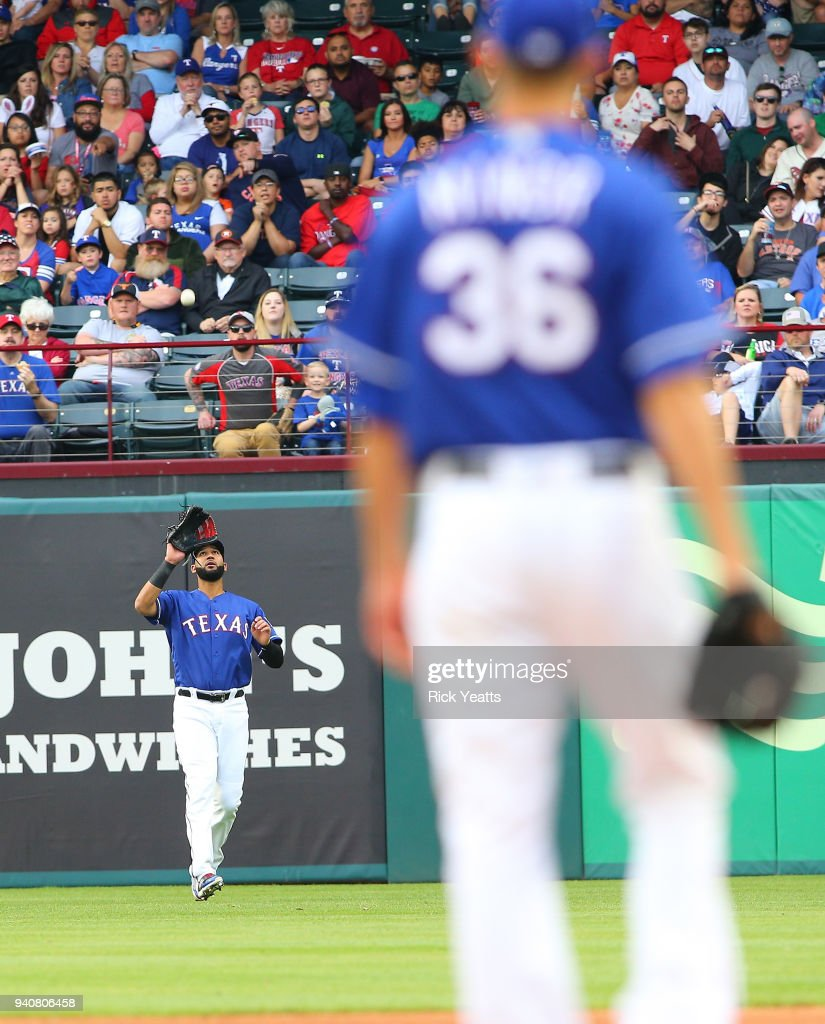 Mike Minor #36 of the Texas Rangers looks on as Nomar Mazara #30 fields a fly ball in the in the fifth inning against the Houston Astros at Globe Life Park in Arlington on April 1, 2018 in Arlington, Texas.