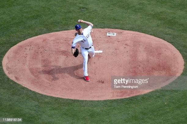 Mike Minor of the Texas Rangers pitches against the Chicago Cubs in the top of the first inning during Opening Day at Globe Life Park in Arlington on...