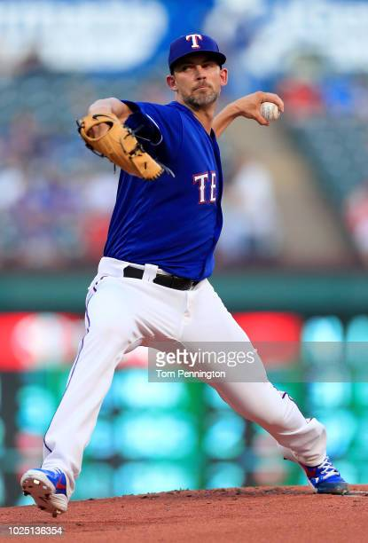 Mike Minor of the Texas Rangers pitches against the Los Angeles Dodgers in the top of the the first inning at Globe Life Park in Arlington on August...