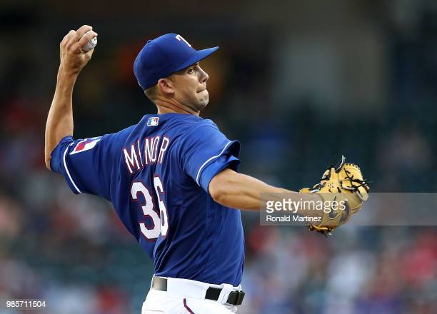 Mike Minor of the Texas Rangers throws against the San Diego Padres in the first inning at Globe Life Park in Arlington on June 27 2018 in Arlington...