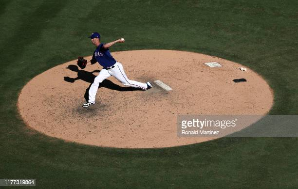 Mike Minor of the Texas Rangers throws his 200th strikeout of the season against the Boston Red Sox in the ninth inning at Globe Life Park in...