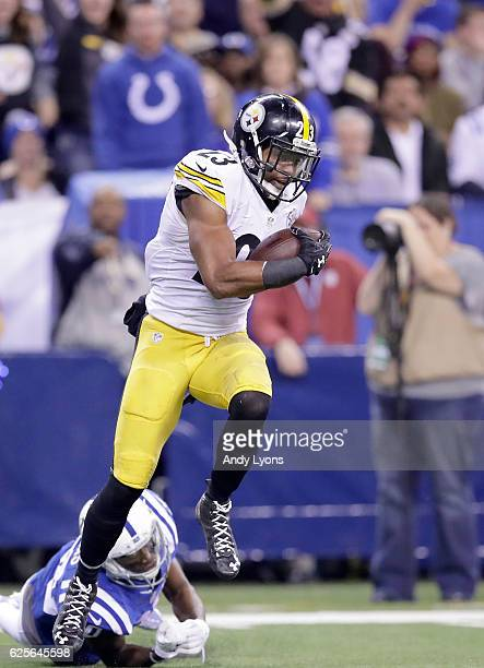 Mike Mitchell of the Pittsburgh Steelers avoids a tackle from Chester Rogers of the Indianapolis Colts during an interception return in the fourth...