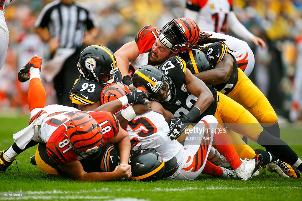 Mike Mitchell #23 of the Pittsburgh Steelers tackles Giovani Bernard #25 of the Cincinnati Bengals in the first half during the game at Heinz Field on September 18, 2016 in Pittsburgh, Pennsylvania.