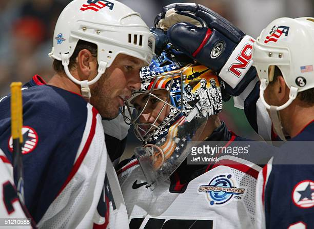 Mike Modano of team USA and Chris Chelios congratulate goaltender Ty Conklin after team USA's 31 defeat of Team Canada in their exhibition game in...