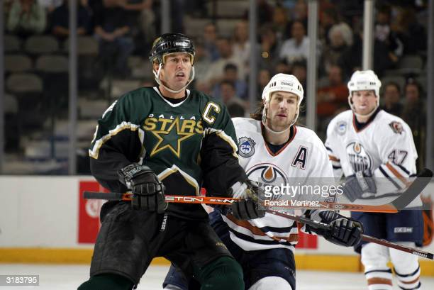 Mike Modano of the Dallas Stars and Ryan Smyth of the Edmonton Oilers skate against each other during play March 31 2004 at the American Airlines...
