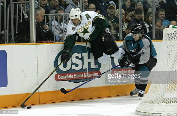 Mike Modano of the Dallas Stars flies past Trevor Daley of the San Jose Sharks on January 30 2007 at the HP Pavilion in San Jose California