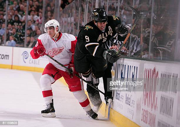 Mike Modano of the Dallas Stars is tripped by Dallas Drake of the Detroit Red Wings during game six of the 2008 NHL Western Conference Finals at the...