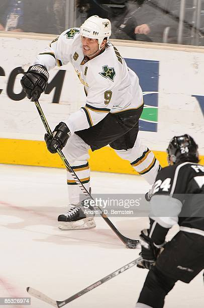 Mike Modano of the Dallas Stars passes the puck against Alexander Frolov of the Los Angeles Kings during the game on March 5 2009 at Staples Center...