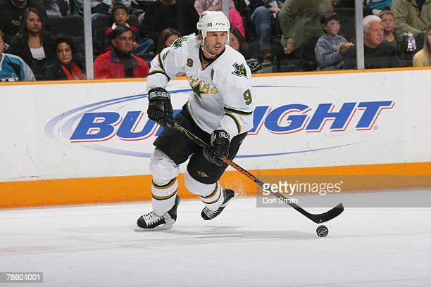 Mike Modano of the Dallas Stars skates with the puck on the ice during an NHL game against the San Jose Sharks on December 15, 2007 at HP Pavilion at...