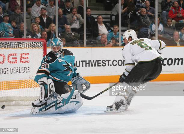 Mike Modano of the Dallas Stars sneaks a goal past Evgeni Nabokov of the San Jose Sharks for his 511th career goal breaking the American scoring...