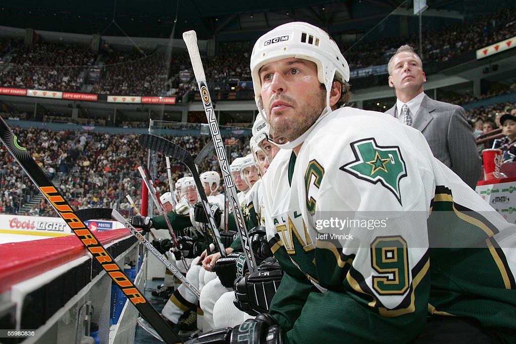 Mike Modano #9 of the Dallas Stars watches the action from the bench during the NHL game against the Vancouver Canucks at General Motors Place on October 16, 2005 in Vancouver, Canada. The Canucks defeated the Stars 5-2.