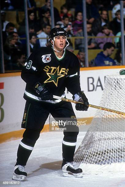 Mike Modano of the Minnesota North Stars skates around the net during an NHL game in November, 1991.