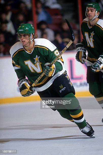Mike Modano of the Minnesota North Stars skates on the ice during an NHL game against the Philadelphia Flyers circa 1991 at the Spectrum in...