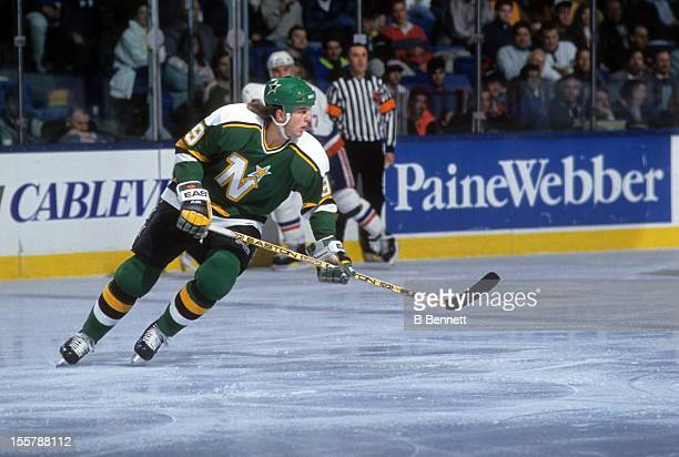 Mike Modano of the Minnesota North Stars skates on the ice during an NHL game against the New York Islanders on February 12, 1991 at the Nassau...