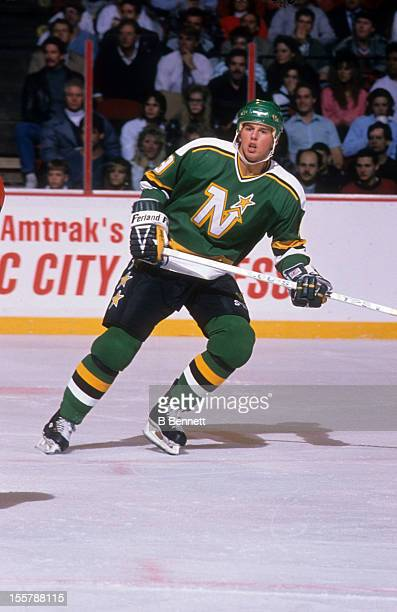 Mike Modano of the Minnesota North Stars skates on the ice during an NHL game against the Philadelphia Flyers on November 1, 1990 at the Spectrum in...