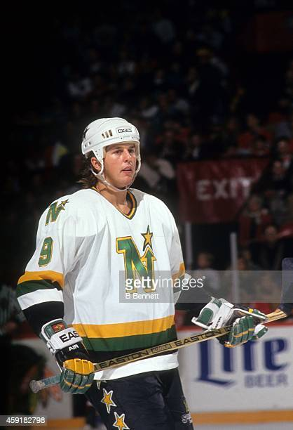 Mike Modano of the Minnesota North Stars skates on the ice during an NHL game against the Chicago Blackhawks circa 1991 at the Chicago Stadium in...