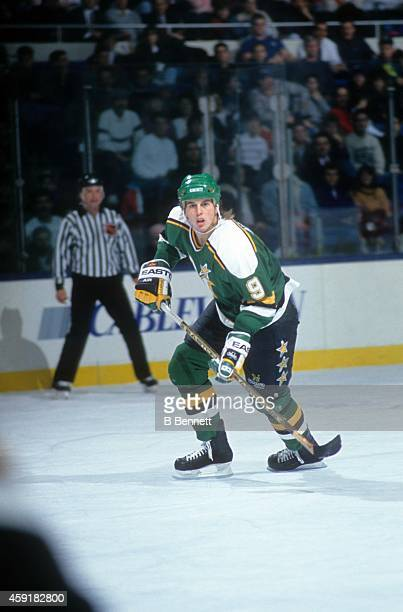 Mike Modano of the Minnesota North Stars skates on the ice during an NHL game against the New York Islanders on January 8, 1991 at the Nassau...