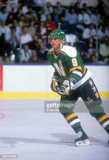 Mike Modano of the Minnesota North Stars skates on the ice during an NHL game against the New York Islanders on October 17, 1989 at the Nassau...