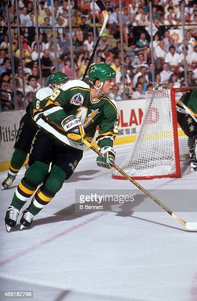 Mike Modano of the Minnesota North Stars skates on the ice during the 1991 Stanley Cup Finals against the Pittsburgh Penguins in May, 1991 at the...