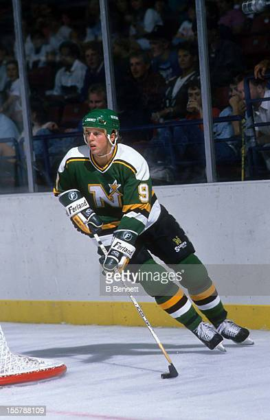 Mike Modano of the Minnesota North Stars skates with the puck during an NHL game against the New York Islanders on January 2, 1993 at the Nassau...