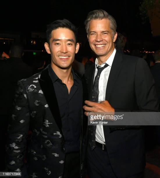 "Mike Moh and Timothy Olyphant pose at the after party for the premiere of Sony Pictures' ""Once Upon A Time...In Hollywood"" at the Hollywood Roosevelt..."