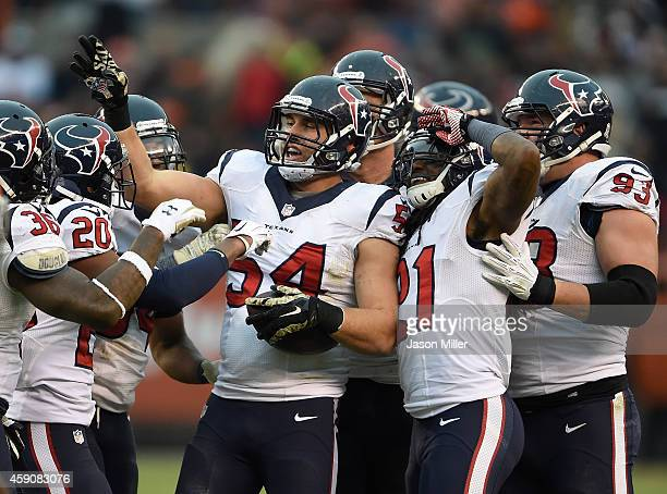 Mike Mohamed of the Houston Texans celebrates his interception with teammates during the fourth quarter against the Cleveland Browns at FirstEnergy...