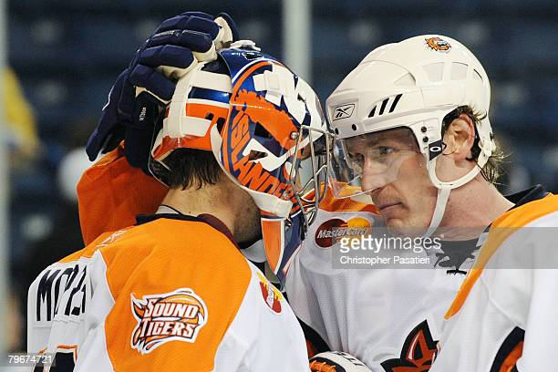 Mike Morrison of the Bridgeport Sound Tigers accepts congratulations from Tim Jackman after defeating the Lowell Devils on February 8 2008 at the...