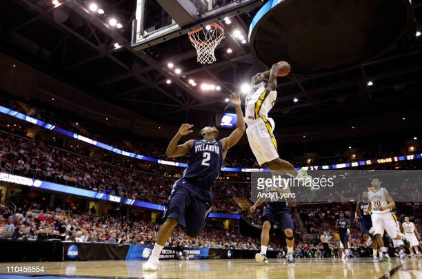 Mike Morrison of the George Mason Patriots dunks over Maalik Wayns of the Villanova Wildcats during the second round of the 2011 NCAA men's...