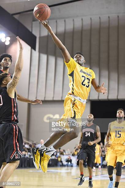 Mike Morsell of the Towson Tigers drives to the basket during the quarterfinals of the Colonial Athletic Conference Tournament college basketball...