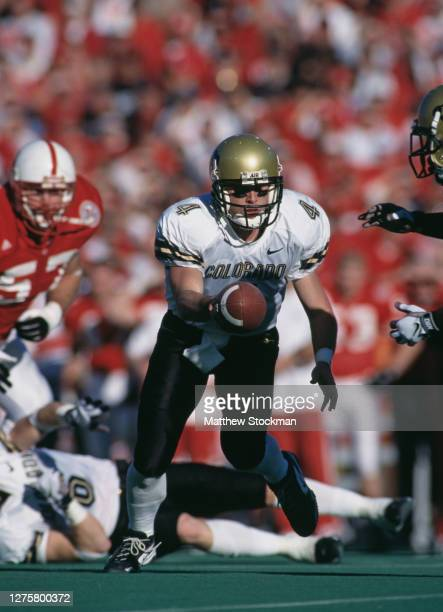 Mike Moschetti, Quarterback for the University of Colorado Buffaloes prepares to hand off the ball during the NCAA Big 12 Conference college football...