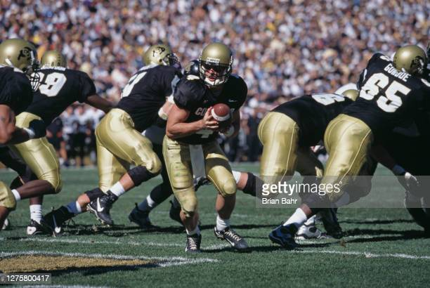 Mike Moschetti, Quarterback for the University of Colorado Buffaloes prepares to hand off the ball during the NCAA Big 12 college football game...