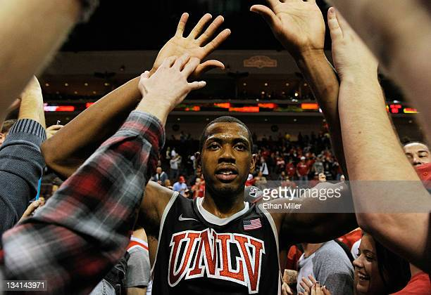 Mike Moser of the UNLV Rebels celebrates with fans after the team's 9080 win over the North Carolina Tar Heels in the championship game of the...