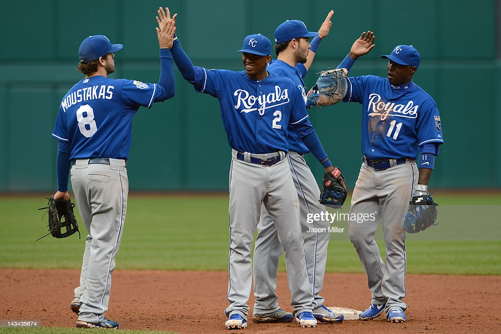Mike Moustakas #8 Alcides Escobar #2 Eric Hosmer #35 and Yuniesky Betancourt #11 of the Kansas City Royals celebrate after defeating the Cleveland Indians 4-2 at Progressive Field on April 26, 2012 in Cleveland, Ohio. The Royals defeated the Indians 4-2.