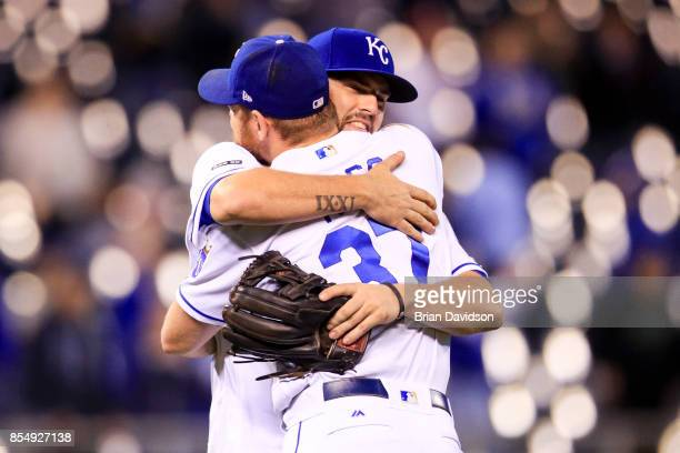 Mike Moustakas and Brandon Moss of the Kansas City Royals hug after the Royals defeated the Detroit Tigers at Kauffman Stadium on September 27 2017...