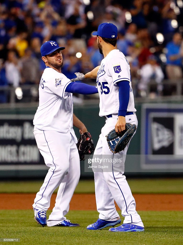 Mike Moustakas #8 and Eric Hosmer #35 of the Kansas City Royals celebrate after the Royals defeated the Detroit Tigers 8-6 to win the game at Kauffman Stadium on April 19, 2016 in Kansas City, Missouri.