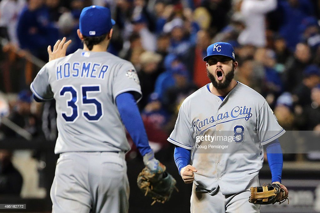 Mike Moustakas #8 and Eric Hosmer #35 of the Kansas City Royals reacts after defeating the New York Mets by a score of 5-3 to win Game Four of the 2015 World Series at Citi Field on October 31, 2015 in the Flushing neighborhood of the Queens borough of New York City.