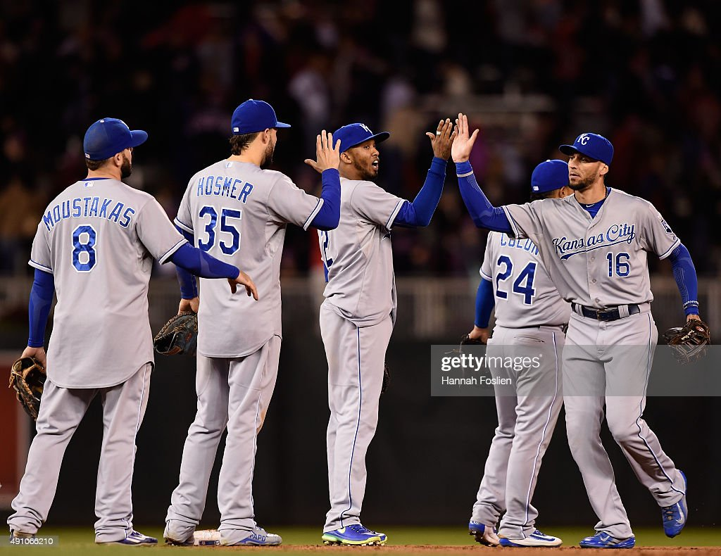 Mike Moustakas #8, Eric Hosmer #35, Alcides Escobar #2, Christian Colon #24 and Paulo Orlando #16 of the Kansas City Royals celebrate a win against the Minnesota Twins on October 2, 2015 at Target Field in Minneapolis, Minnesota. The Royals defeated the Twins 3-1.