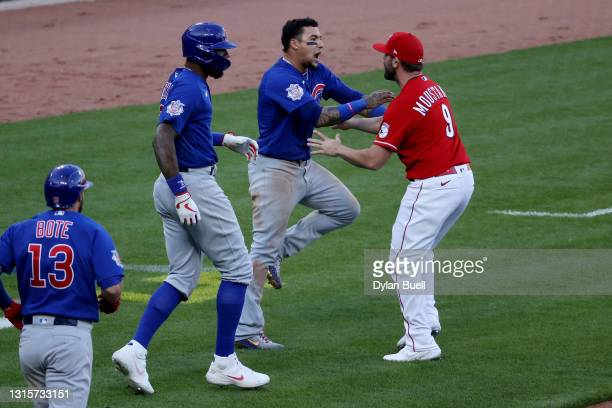 Mike Moustakas of the Cincinnati Reds confronts Javier Baez of the Chicago Cubs during a bench clearing incident in the eighth inning at Great...