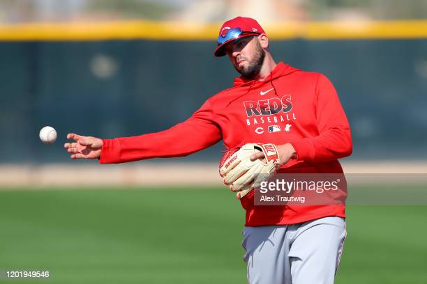 Mike Moustakas of the Cincinnati Reds throws to first base during a workout on Wednesday, February 19, 2020 at Goodyear Ballpark in Goodyear, Arizona.