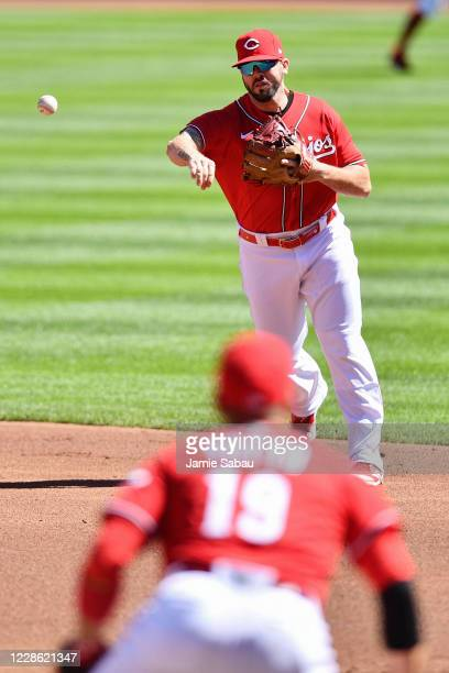 Mike Moustakas of the Cincinnati Reds throws to first baseman Joey Votto of the Cincinnati Reds in the second inning against the Chicago White Sox at...