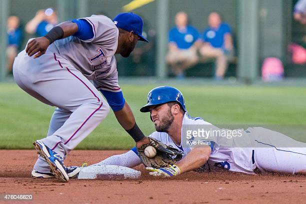 Mike Moustakas of the Kansas City Royals attempts to avoid the tag at second base from Hanser Alberto of the Texas Rangers in the first inning at...