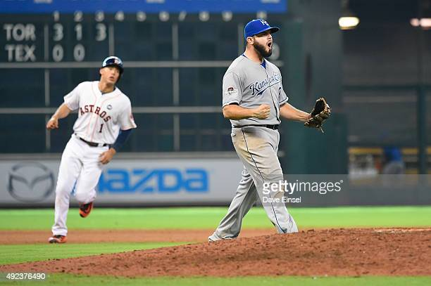 Mike Moustakas of the Kansas City Royals celebrate defeating the Houston Astros in Game 4 of the ALDS at Minute Maid Park on Monday October 12 2015...