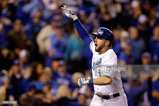 Mike Moustakas of the Kansas City Royals celebrates after hitting a solo home run in the seventh inning against the San Francisco Giants during Game...