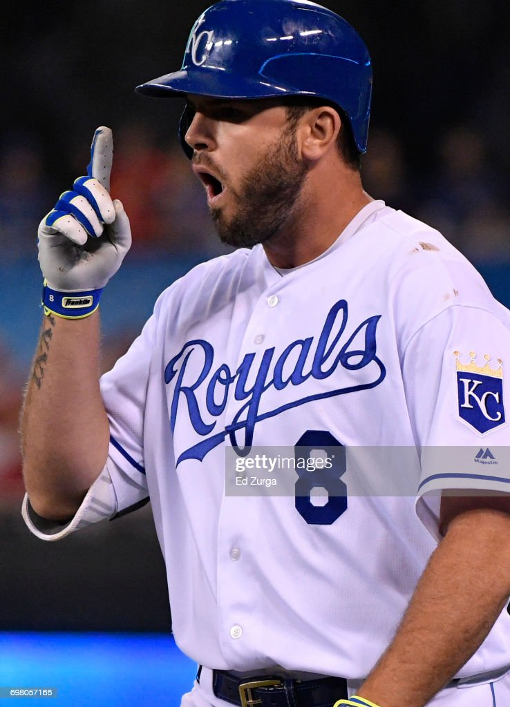 Mike Moustakas #8 of the Kansas City Royals celebrates his bunt single in the sixth inning against the Boston Red Sox at Kauffman Stadium on June 19, 2017 in Kansas City, Missouri.